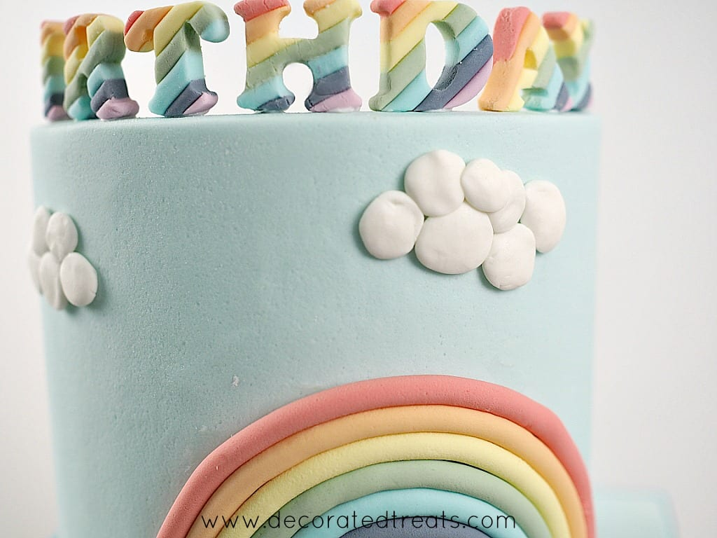 A group of fondant clouds on a cake