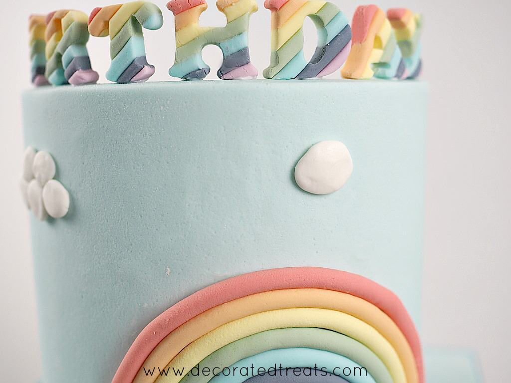 A flat fondant piece on a blue cake