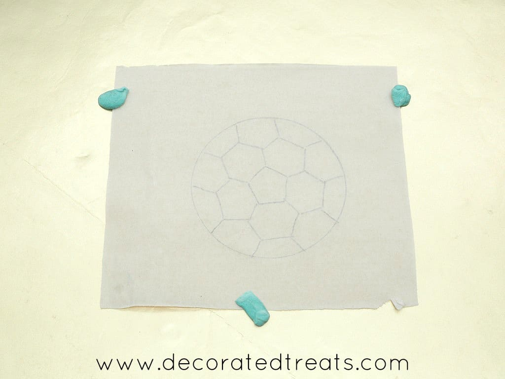 Soccer ball template glued to a cake board