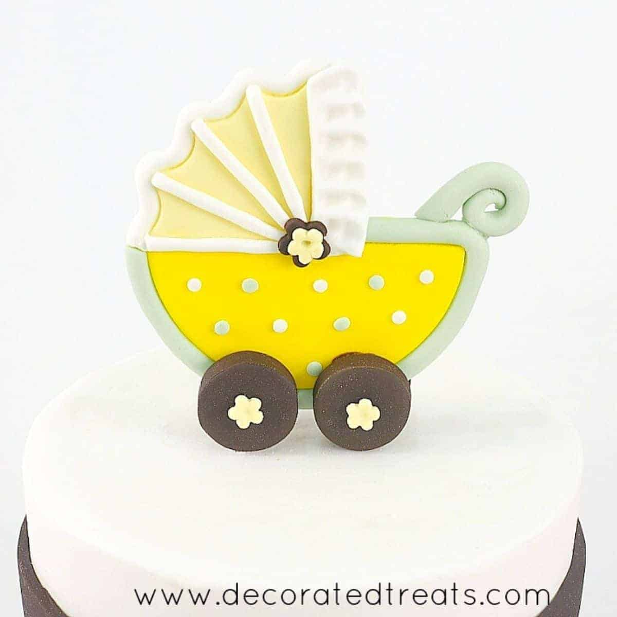 Stroller baby shower cake topper in yellow and green