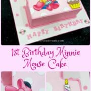 A number one shaped cake decorated with a Minnie Mouse baby image and a cup image. The cake is in pink with white polka dots while the cake board is white in pink polka dots