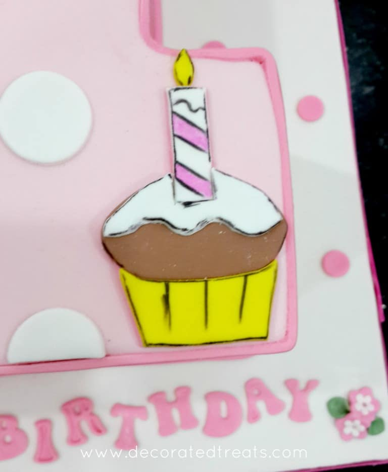 Close up on a cupcake image cut out of fondant