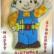 Bob the Builder cake on a gold cake board