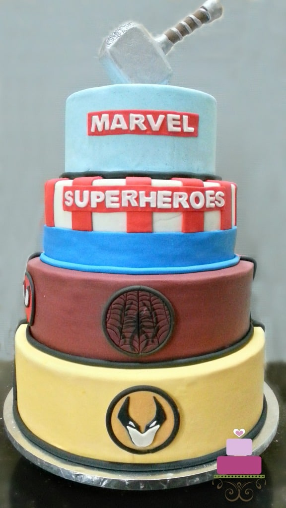 A 4-tier Marvel Superhero birthday cake with Thor hammer topper
