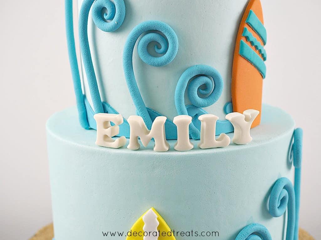 3D alphabets on a blue cake