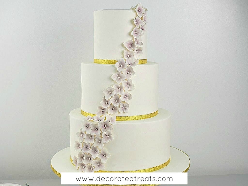 A three tier cake with cascading gum paste hydrangea flowers