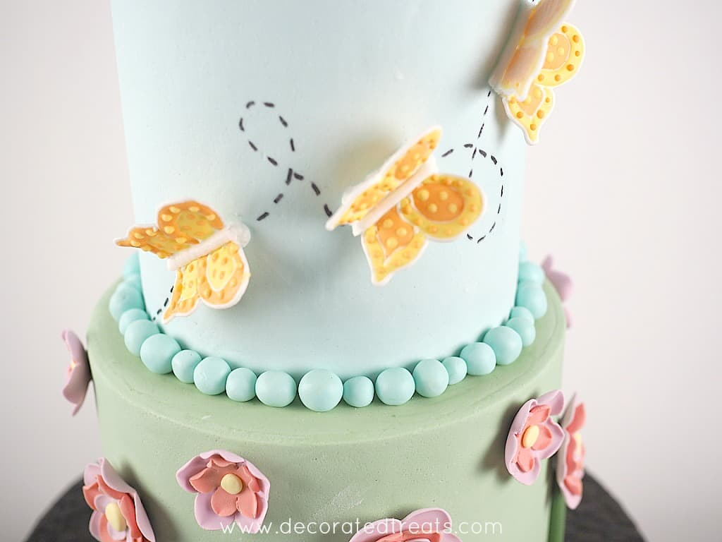 The sides of a cake with 3D butterflies