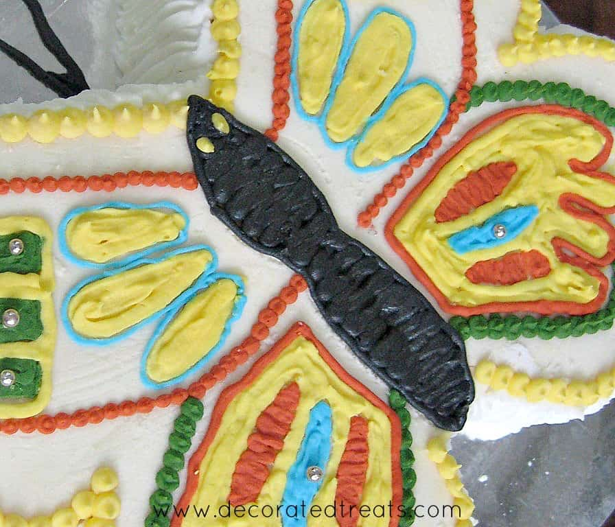 Butterfly cake body in black icing