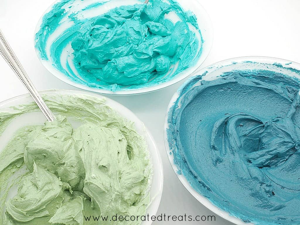 Buttercream in green, blue and turquoise in small bowls