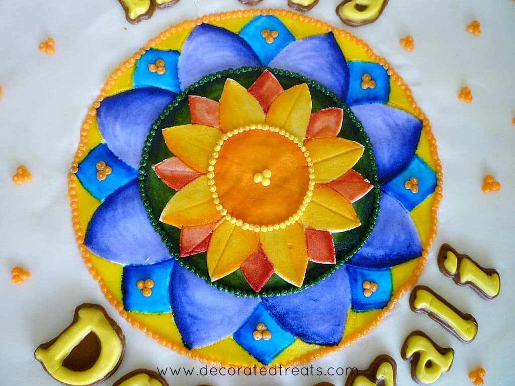 Rangoli design painted on fondant