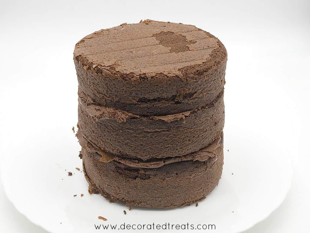 3 layers of chocolate cake with chocolate icing in between each layer
