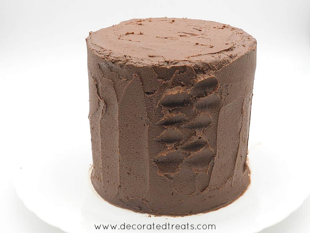 A round cake decorated in chocolate icing