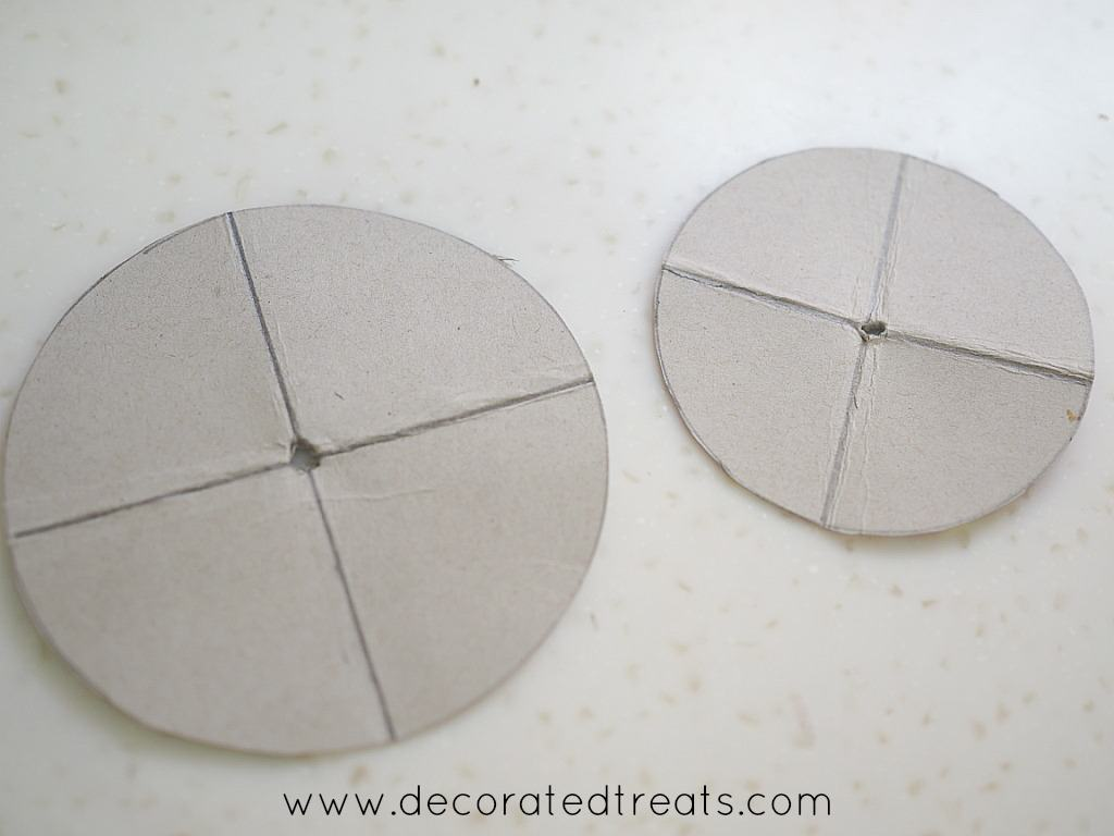 2 round grey card boards with holes in the center