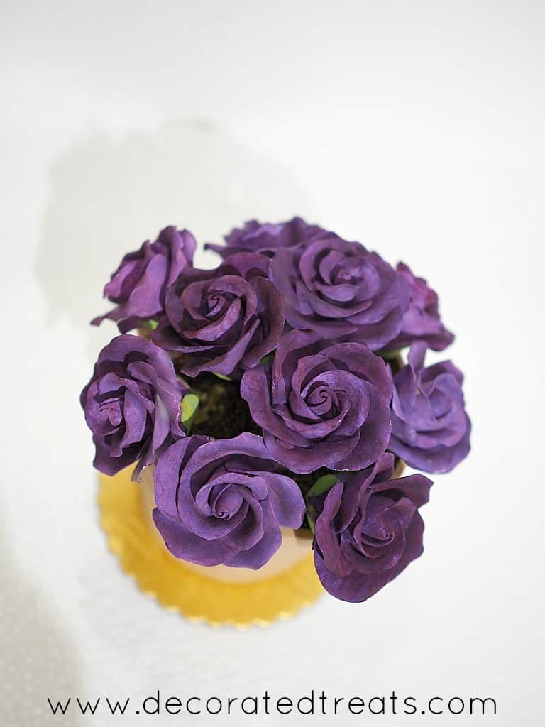 Top view of a flower pot shaped cake with purple roses