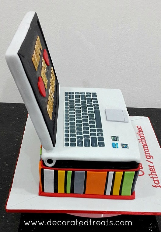 A laptop shaped cake