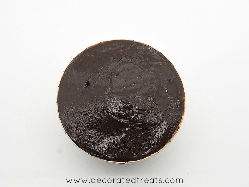 A ganache covered cupcake top