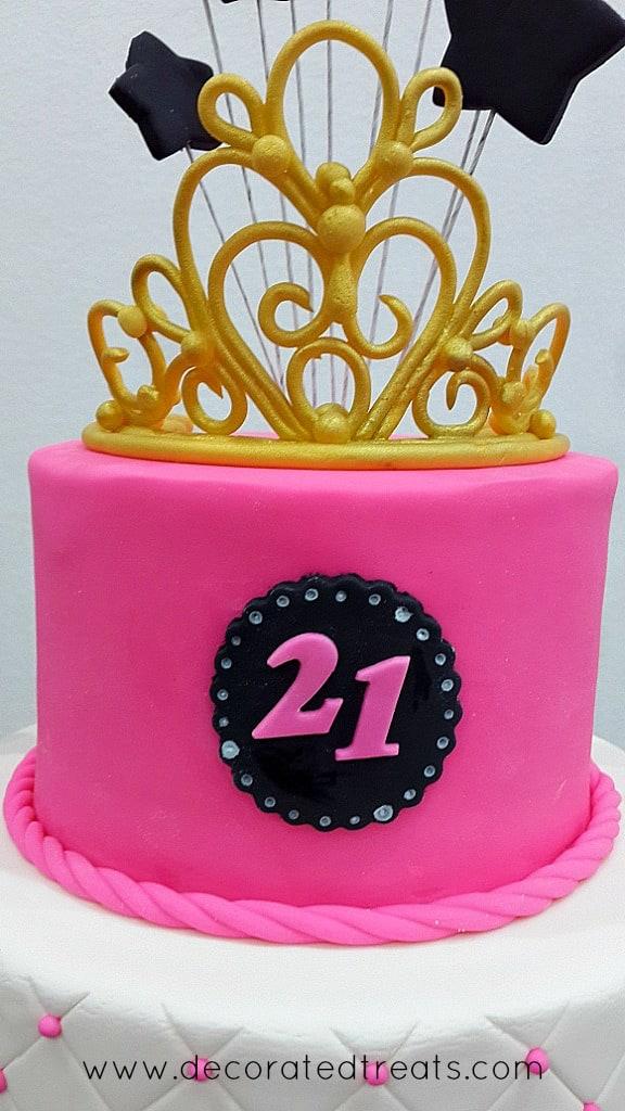 Gold tiara on a pink cake