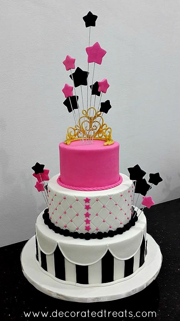 The back of a 3 tier pink, white and black 21st birthday cake