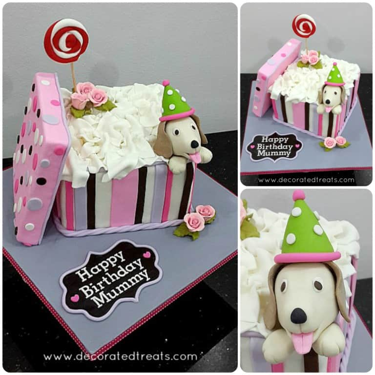A square cake decorated like a gift box with its lid on the side a puppy topper at the corner of the box.