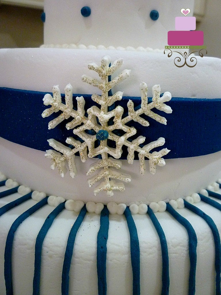 A large royal icing snowflake on a cake