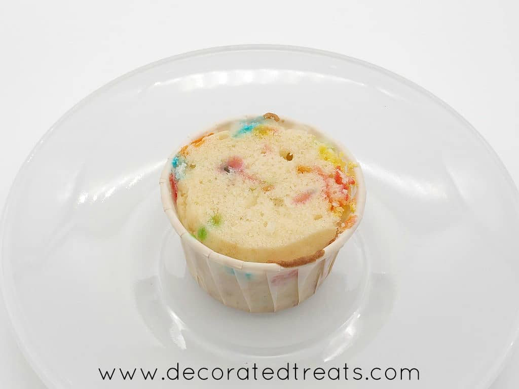 A funfetti cupcake with the top leveled