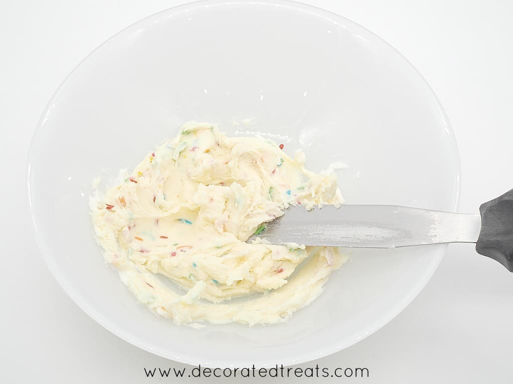 Buttercream with sprinkles in a plate