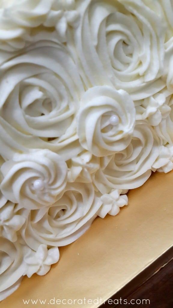 White buttercream rosettes on a cake