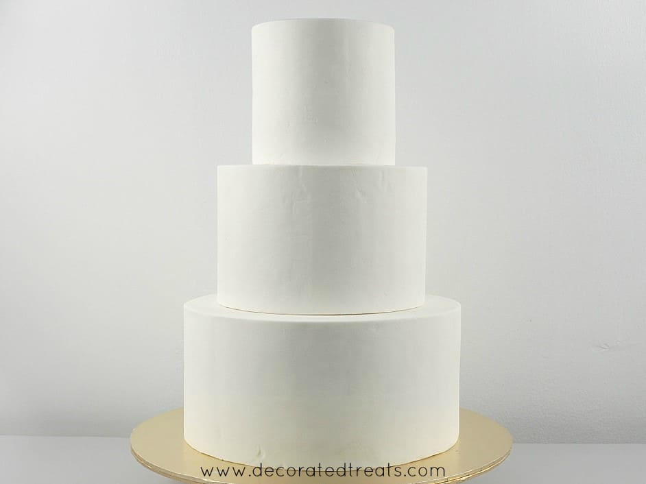 3 tiers of white fondant covered cakes stacked