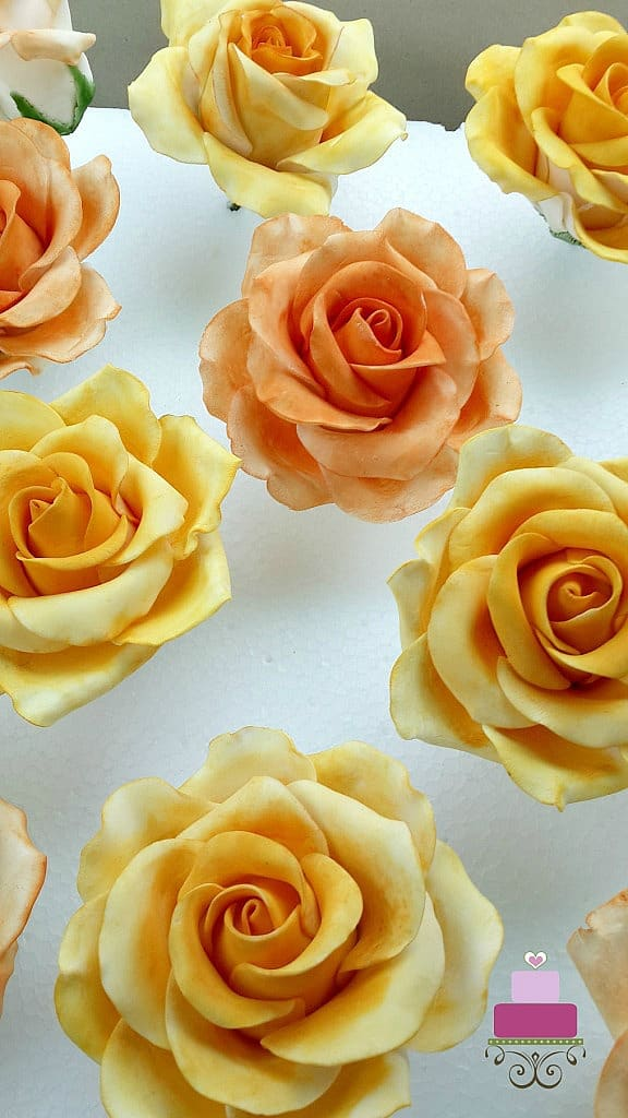 gum paste roses in yellow and orange