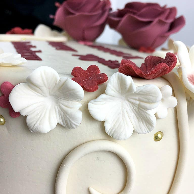Close up of white fondant flowers on a cake