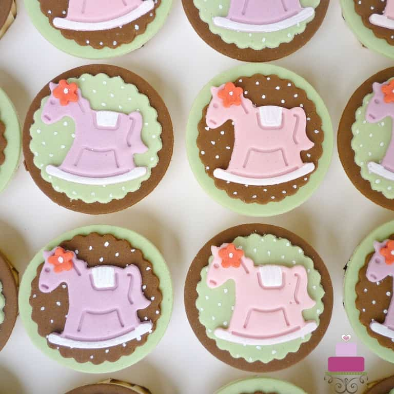 Baby cupcakes with rocking horse deco in fondant