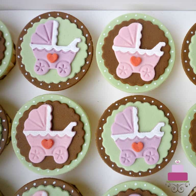 Baby cupcakes with baby stroller fondant deco