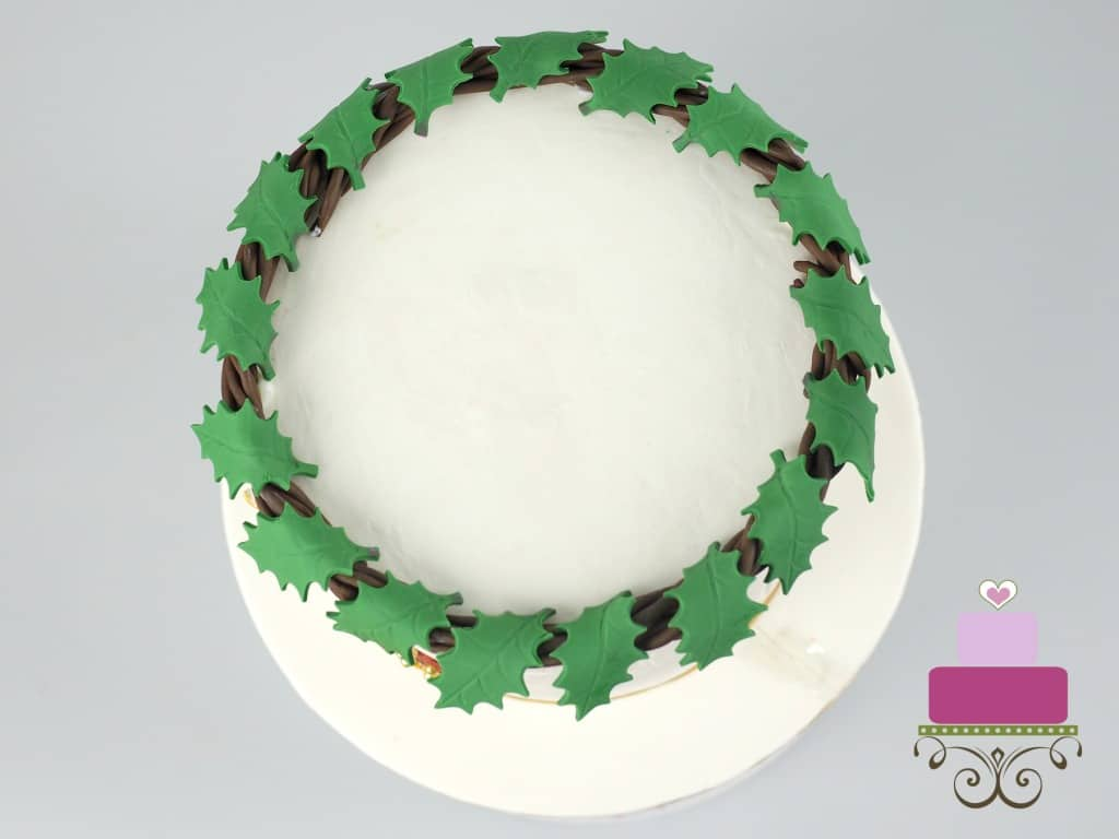 Holly leaves garland on a cake