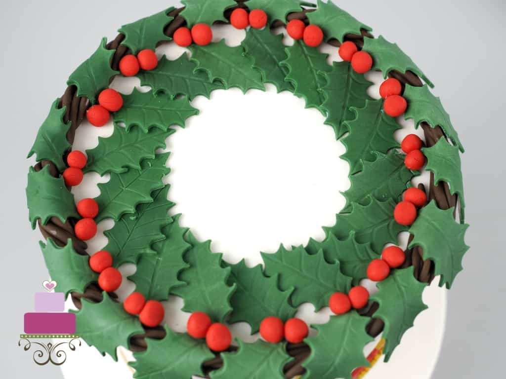 Holly berries garland on top of a round cake