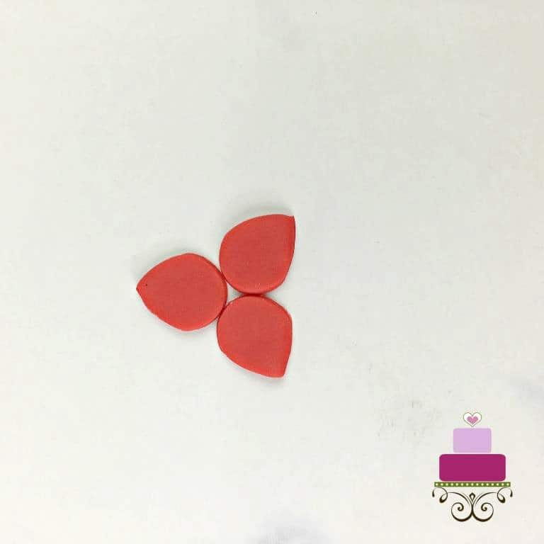 3 red fondant petals attached together in the center