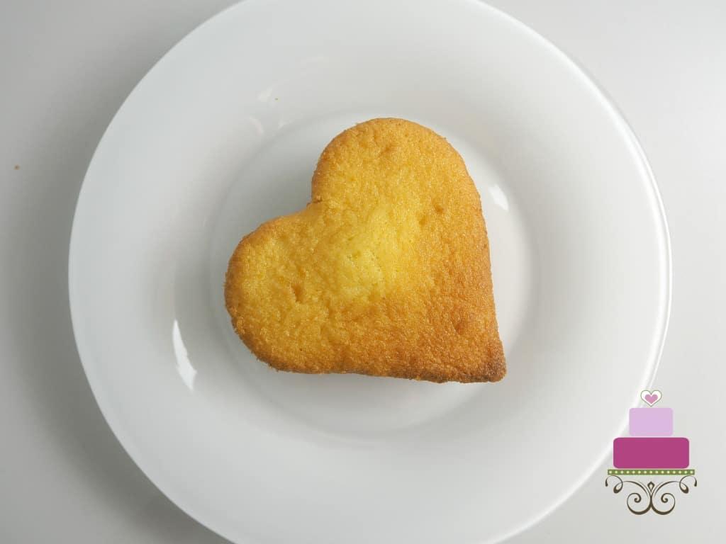 A mini heart shaped cake on a white plate