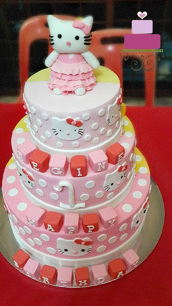 A dual toned Hello Kitty, 3 tier cake with Hello Kitty topper