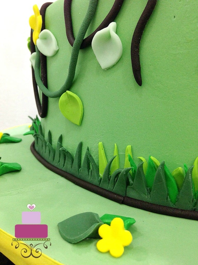 Fondant grass on the sides of a green cake
