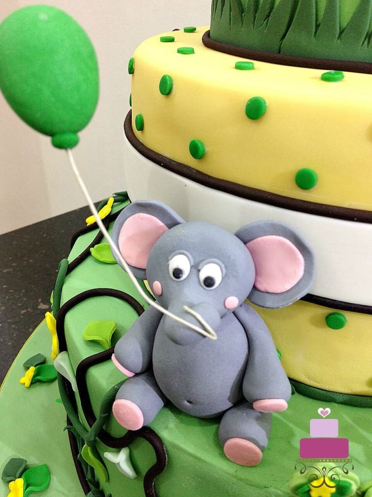 3d fondant elephant with a string around its trunk