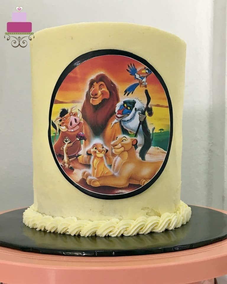 The front of a cake decorated with the Lion King themed edible image