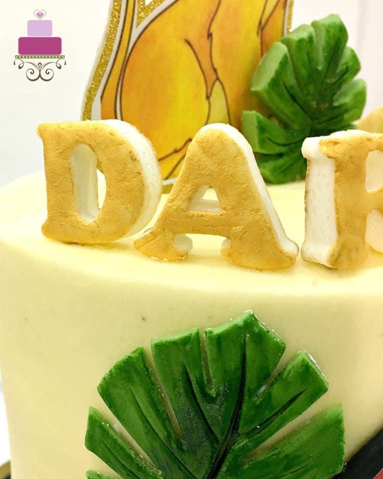 3D gold fondant lettering on cake