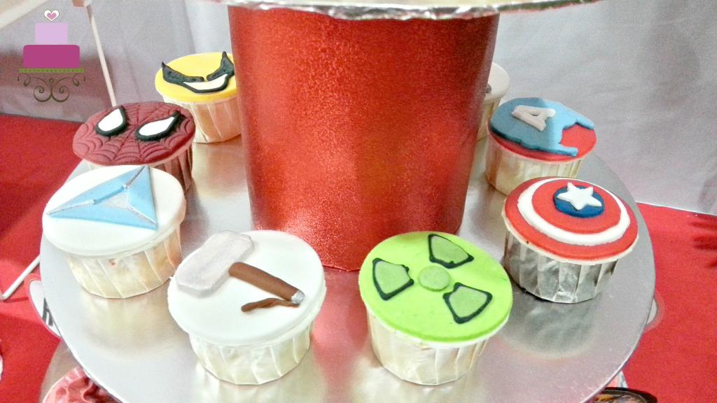 Cupcakes decorated in Marvel Superheroes theme on a cupcake stand