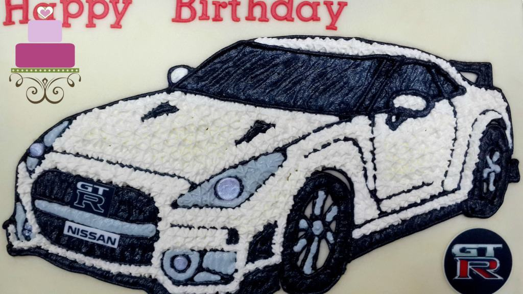 Nissan GTR car image in star piping on a cake