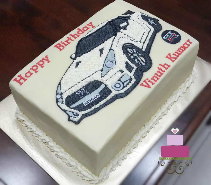 A rectangle cake decorated with Nissan GTR car image in buttercream