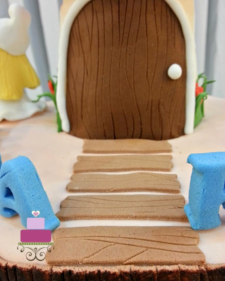 Fondant wood walkway on a cake