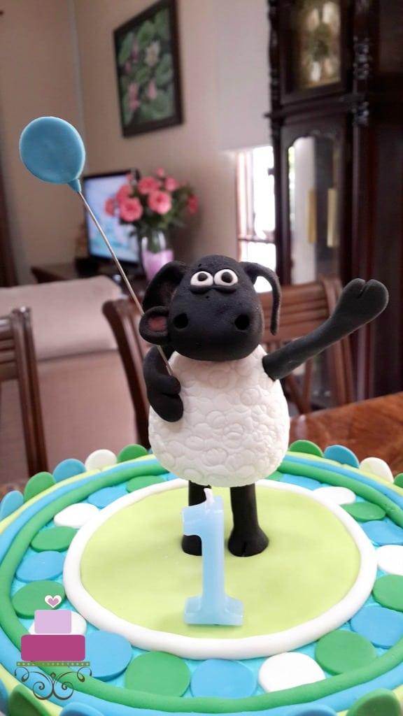 Timmy cake topper, holding a fondant balloon
