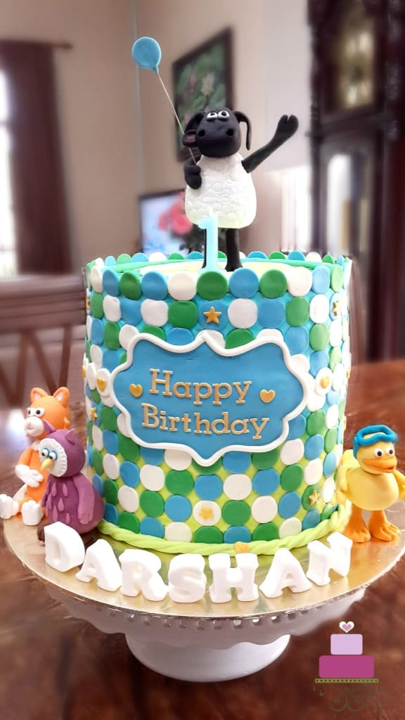 A double barrel Timmy Time cake with Timmy cake topper holding a balloon
