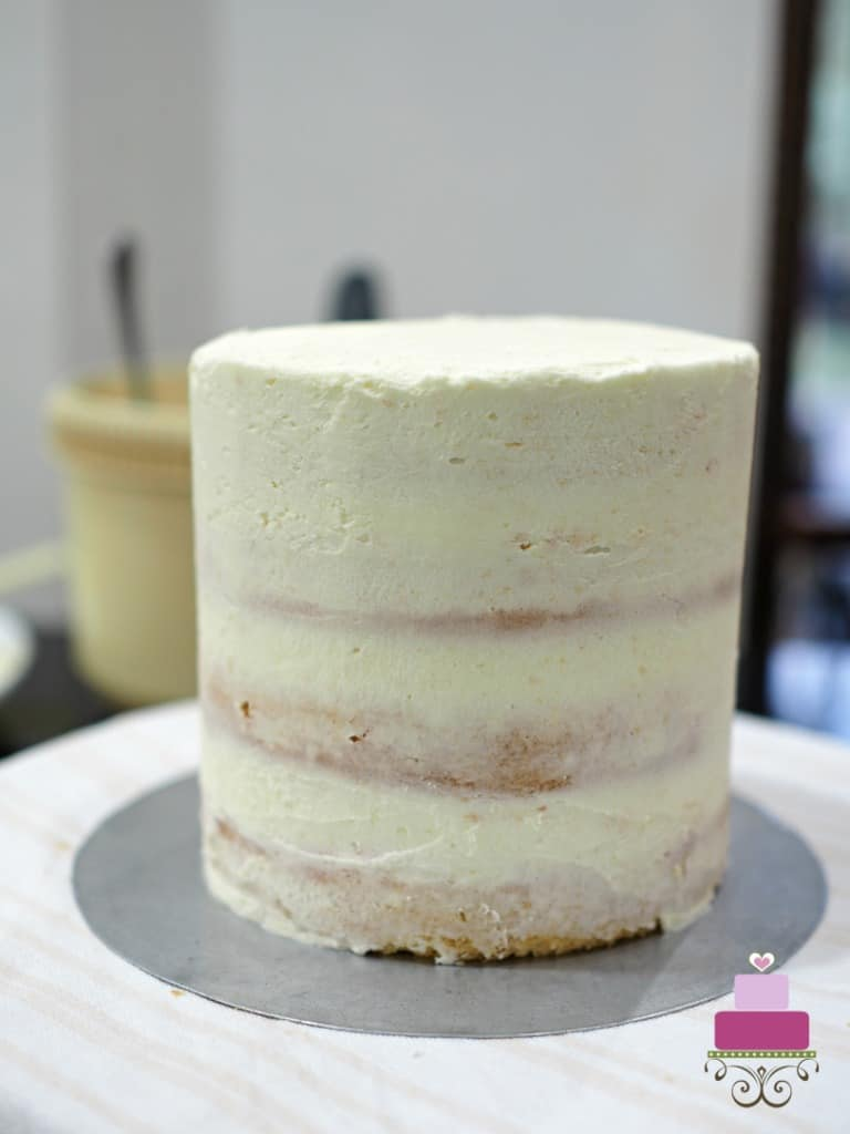 A crumbcoated cake