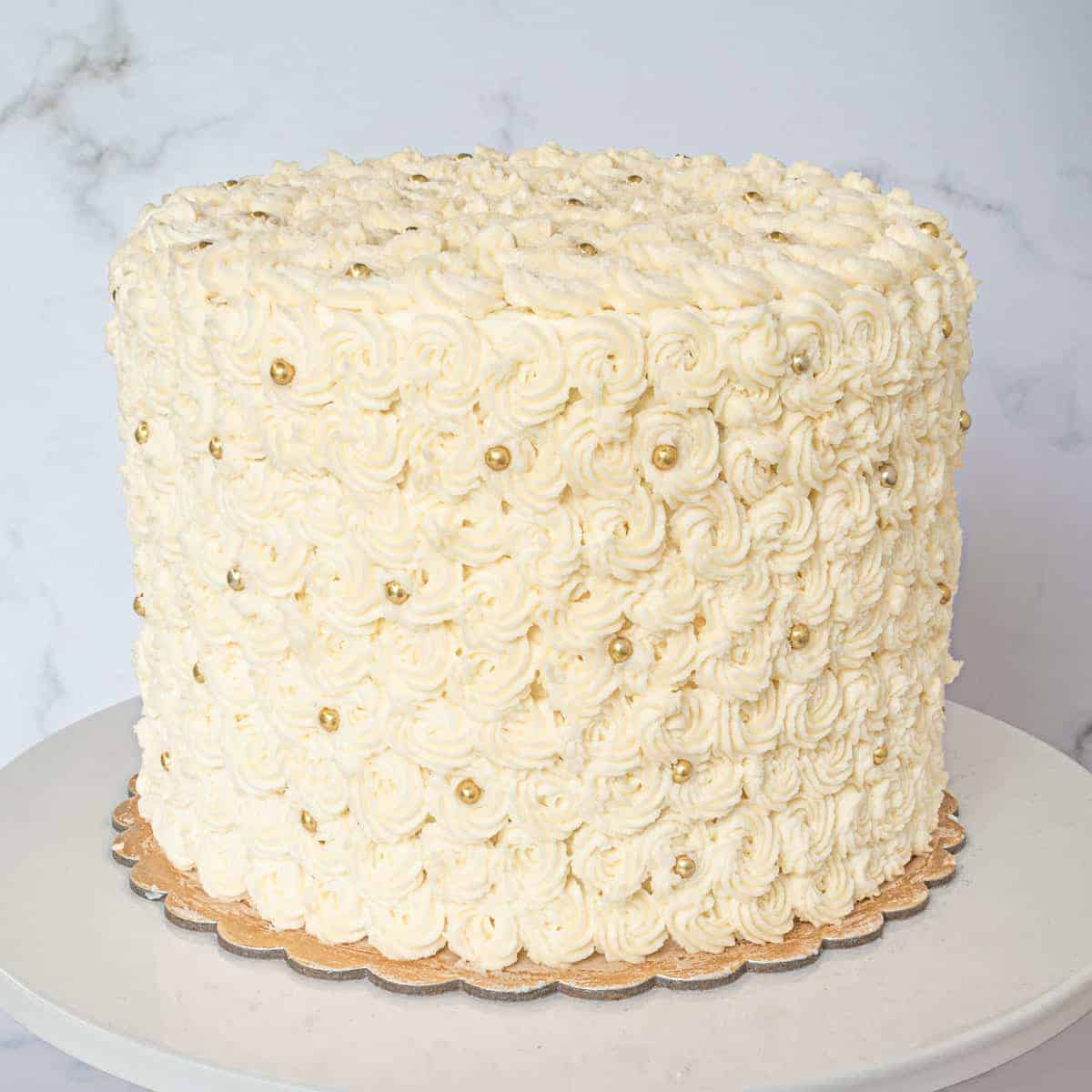A round cake covered in buttercream rosettes