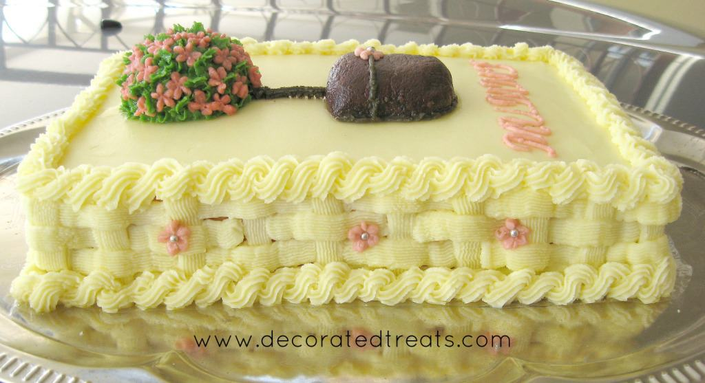 Poster for a rectangle cake decorated with buttercream topiary in pink